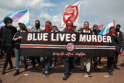 Ultras from Clapton Community FC march behind a Blue Lives Murder banner at a Kill The Bill demonstration as part of a National Day of Action to mark International Workers Day on 1st May 2021 in London, United Kingdom. Nationwide protests have been organised against the Police, Crime, Sentencing and Courts Bill 2021, which would grant the police a range of new discretionary powers to shut down protests.