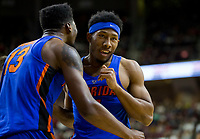 Florida guard KeVaughn Allen (5) reacts with teammate forward Kevarrius Hayes (13) after a called foul against Texas A&M during the first half of an NCAA college basketball game Tuesday, Jan. 2, 2018, in College Station, Texas. (AP Photo/Sam Craft)