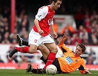 Photo. Daniel Hambury, Digitalsport<br /> Arsenal v Sheffield United. <br /> FA Cup Fifth Round.<br /> 19/2/2005.<br /> Arsenal's Mathieu skips past a grounded Sheffield United's Jon Harley.