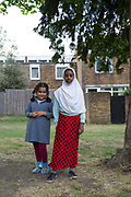 Two girls at Cressingham Gardens estate on 11th May 2017 in South London, United Kingdom. Cressingham Gardens is a council garden estate in Lambeth. Located on the southern edge of Brockwell Park, it comprises of 306 dwellings. It was designed at the end of the 1960s by the Lambeth Borough Council architect Edward Hollamby, and built at the start of the 1970s. In 2012 Lambeth Council proposed regeneration of the whole estate, a decision highly opposed by many residents and a campaign to stop the redevelopment has been in place since.