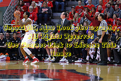 14 January 2017:  Gregg Marshall stands in front of his bench next to referee Tom O'Neill watching a 3 point shot by Deontae Hawkins(23) during an NCAA  MVC (Missouri Valley conference) mens basketball game between the Wichita State Shockers the Illinois State Redbirds in  Redbird Arena, Normal IL