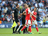 Arsenal's Alexis Sanchez complains to referee Craig Pawson during the FA Cup Semi Final match at Wembley Stadium, London. Picture date: April 23rd, 2017. Pic credit should read: David Klein/Sportimage