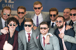 TODAY PICTURE © Licensed to London News Pictures. 06/06/2014. Epsom, UK. A group of men pose for a picture.  Ladies Day today 6th June 2014 at Epsom 2014 Investic Derby Festival in Surrey. Traditionally, elegant, fashionable racegoers gather for a classic day's racing at Epsom Racecourse, Surrey. Photo credit : Stephen Simpson/LNP