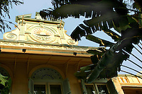 """Facade of the Authors Wing at the Oriental Hotel, widely recognized as """"the best hotel in the world"""" largely because of its renowned service and location on the Chao Phrya River in Bangkok."""