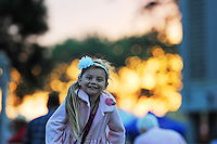 """A girl enjoys hanging on the fence at Thursday's """"Tough Enough To Wear Pink"""" night at the 2014 California Rodeo Salinas."""