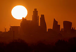 CAPTION CORRECTION © Licensed to London News Pictures. 07/05/2021. London, UK. The morning sun rises over the City of London. Colder wetter weather is expected over the weekend and into next week. Photo credit: Peter Macdiarmid/LNP