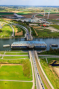 Nederland, Zeeland, Zeeuws-Vlaanderen, 09-05-2013; Sluiskil, Kanaal Gent-Terneuzen, kanaalkruising Sluiskil. De brug in de N61 sluit zeer regelmatig voor zeeschepen en dit veroorzaakt files. Daarom zal de kanaalbrug vervangen worden door een tunnel, de Sluiskiltunnel (oplevering 2015).<br /> The pivot bridge over the canal Gent-Terneuzen (Zeeland) closes very regularly for seagoing vessels and this causes traffic jams. Therefore, the canal bridge will be replaced by a tunnel, the tunnel Sluiskil (completion 2015).<br /> luchtfoto (toeslag op standard tarieven);<br /> aerial photo (additional fee required);<br /> copyright foto/photo Siebe Swart.