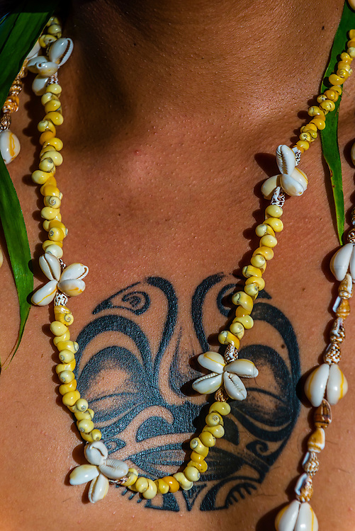 Polynesian man with tattooed chest and necklace, Four Seasons Resort Bora Bora, French Polynesia.