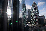 Views of the cityscape skyline looking towards 1 St Mary Axe aka the Gherkin from The Garden at 120, the City of London's largest rooftop public space, located atop the newly opened Fen Court office building at 120 Fenchurch Street in London, United Kingdom. At 15-storeys up, the viewing platform offers exceptional 360-degree views of the City and greater London, and is free for members of the public to visit.