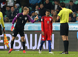 Joe Hart of England tells Jesse Lingard of England to calm  down after confronting Slovenia players - Mandatory by-line: Robbie Stephenson/JMP - 11/10/2016 - FOOTBALL - RSC Stozice - Ljubljana, England - Slovenia v England - World Cup European Qualifier