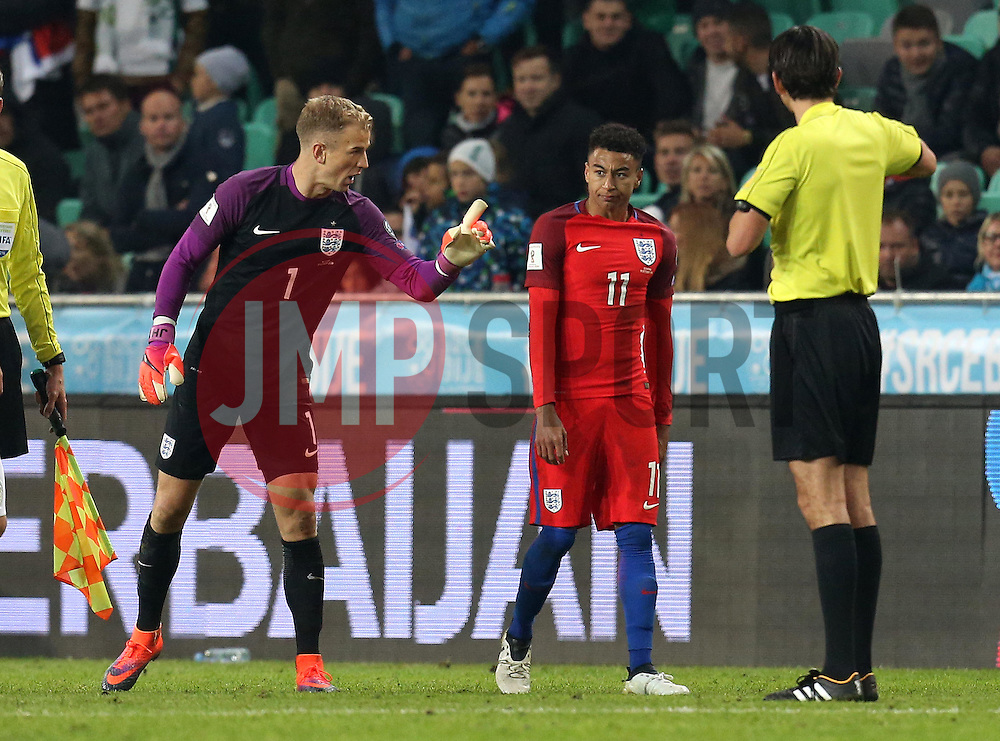 Joe Hart of England tells Jesse Lingard of England to calm  down after confronting Slovenia players - Mandatory by-line: Robbie Stephenson/JMP - 11/10/2016 - FOOTBALL - RSC Stozice - Ljubljana, England - Slovenia v England - World Cup European Qualifier