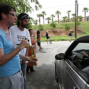 "Kelly Benjamin (left), a local Tampa protester, talks with an unidentified man who is recording him at ""Camp Romney"", during the Republican National Convention in Tampa, Fla. on Wednesday, August 29, 2012. (AP Photo/Alex Menendez)"