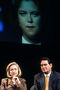 US first lady Hillary Clinton with Congressmen Billy Tauzin during an event on smarter television watching at the White House as actress Rosie O'Donnell participates on video link February 25, 1997 in Washington, DC.