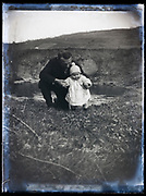 father posing with baby toddler France 1921