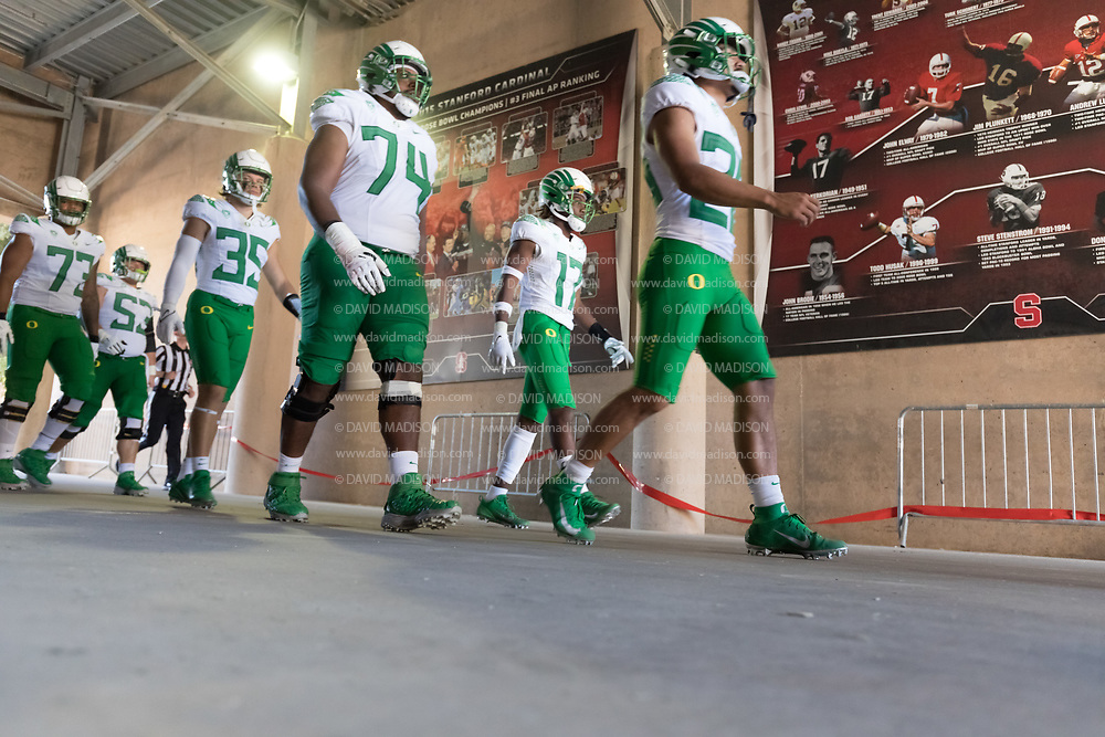 PALO ALTO, CA - OCTOBER 2:  Steven Jones #74, Micah Roth #35, and Jaylan Jeffers #73 of the Oregon Ducks and teammates enter the stadium before the second half of an NCAA Pac-12 college football game against the Stanford Cardinal on October 2, 2021 at Stanford Stadium in Palo Alto, California.  (Photo by David Madison/Getty Images)