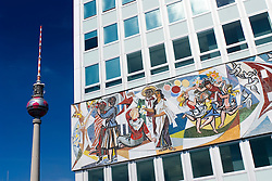 East German era socialist murals depicting workers utopia on Haus des Lehrers at Alexanderplatz in Berlin