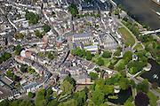 Nederland, Limburg, Gemeente Maastricht, 27-05-2013; <br /> De oever van de Maas en Maasboulevard (r ) met het Stadspark en de stadsmuur  De Pieterstraat (centrale straat) met de Franciscanerkerk(r )  en de Waalse kerk(l), beide Rijksmonument. Witte huis  met zwart dak in het groen is het Pesthuis (rechtsbeneden).<br /> The bank of the river Maas (Meuse) and the Maasboulevard. Next to it the public park en the town walls . Old town with some churches.<br /> luchtfoto (toeslag op standaardtarieven);<br /> aerial photo (additional fee required);<br /> copyright foto/photo Siebe Swart.