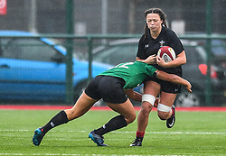 Wales women's Alisha Butchers is tackled by Ireland women's Sene Naoupu<br /> <br /> Photographer Craig Thomas/Replay Images<br /> <br /> International Friendly - Wales women v Ireland women - Sunday 21th January 2018 - CCB Centre for Sporting Excellence - Ystrad Mynach<br /> <br /> World Copyright © Replay Images . All rights reserved. info@replayimages.co.uk - http://replayimages.co.uk