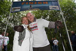 John with his wife Sarah at the finish line..The John Hartson Foudation walk up Ben Nevis..Pic ©2010 Michael Schofield. All Rights Reserved.