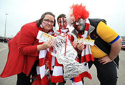 Lincoln City fans Jonathon, Michael and Beth Belshaw depart for London from Sincil Bank, Lincoln.
