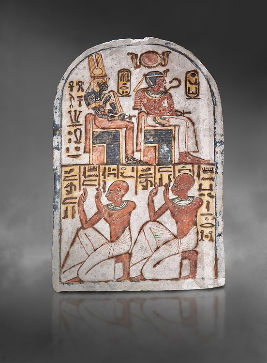 """Ancient Egyptian Stele of Amenemope dedicated to Amenhotep I and Ahmose-Nefertari, limestone, New Kingdom, 19th Dynasty, (1279-1213 BC), Deir el-Medina, Drovetti cat 1454. Egyptian Museum, Turin. Grey background.<br /> <br /> The stele is dedicated to Amenhotep I and Ahmose-Nefertari by the 'Servant in the Place of Truth' Amenemope and Amennakht. The king and the queen are shown sitting on their thrones. Above the sovereign there is a solar disc flanked by two sacred cobras and their cartouches are shown to the right of each of them. In the bottom register Amenemope is shown with his son  Amennakht, who also was a """"Servant in the Place of Truth"""", in the pose of adoration. .<br /> <br /> If you prefer to buy from our ALAMY PHOTO LIBRARY  Collection visit : https://www.alamy.com/portfolio/paul-williams-funkystock/ancient-egyptian-art-artefacts.html  . Type -   Turin   - into the LOWER SEARCH WITHIN GALLERY box. Refine search by adding background colour, subject etc<br /> <br /> Visit our ANCIENT WORLD PHOTO COLLECTIONS for more photos to download or buy as wall art prints https://funkystock.photoshelter.com/gallery-collection/Ancient-World-Art-Antiquities-Historic-Sites-Pictures-Images-of/C00006u26yqSkDOM"""