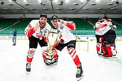Zan Jezovsek and Blaz Tomazevic of HDD SIJ Acroni Jesenice celebrate with trophy after ice hockey match between HK SZ Olimpija and HDD SIJ Acroni Jesenice in fifth game of Final at Slovenian National League, on May 10, 2021 in Hala Tivoli, Ljubljana, Slovenia. Photo by Matic Klansek Velej / Sportida