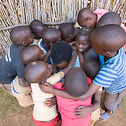 CAPTION: When Theresia came home after her operation, her grandchildren were overjoyed and couldn't stop telling her how good she looked. LOCATION: Rutare, Byumba-Gichumbi, Rwanda. INDIVIDUAL(S) PHOTOGRAPHED: N/A.