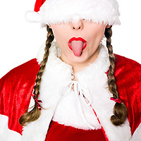 close up portrait of one woman dressed as santa claus christmas blindfold hat tongue sticking out on studio isolated white background