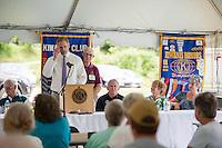St. Johnsbury Academy Headmaster Tom Lovett speaks to the crowd during the 70th Anniversary celebration of the Kiwanis Pool in St. Johnsbury Vermont.  Karen Bobotas / for Kiwanis International
