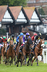 Sneaky Peek (right) leads the field on the first lap of The Sportpesa Maiden Stakes, during Boodles City Day at Chester Racecourse, Chester.