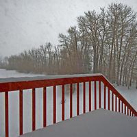 Snow caps a banister during a storm near Bozeman, Montana.