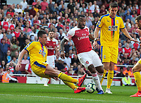 Football - 2018 / 2019 Premier League - Arsenal vs Crystal Palace<br /> <br /> Martin Kelly of Palace tackles Alexandre Lacazette of Arsenal at the Emirates<br /> <br /> Colorsport  / Andrew Cowie