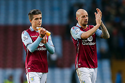 Jack Grealish and Alan Hutton of Aston Villa leave the pitch after Arsenal win the match 0-2 - Mandatory byline: Rogan Thomson/JMP - 13/12/2015 - FOOTBALL - Villa Park Stadium - Birmingham, England - Aston Villa v Arsenal - Barclays Premier League.