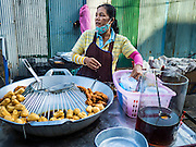 29 SEPTEMBER 2015 - BANGKOK, THAILAND:  A street food vendor in Bang Chak Market. The Bang Chak Market serves the community around Sois 91-97 on Sukhumvit Road in the Bangkok suburbs. About half of the market has been torn down, vendors in the remaining part of the market said they expect to be evicted by the end of the year. The old market, and many of the small working class shophouses and apartments near the market are being being torn down. People who live in the area said condominiums are being built on the land.       PHOTO BY JACK KURTZ
