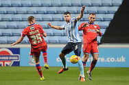Coventry City defender Chris Stokes and \o35 about to tackle during the Sky Bet League 1 match between Coventry City and Oldham Athletic at the Ricoh Arena, Coventry, England on 19 December 2015. Photo by Alan Franklin.