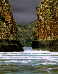 A storm builds in Talbot Bay behind the Horiztonal Waterfalls in the Kimberley Wet Season.  The Horizontal Waterfalls are pinch neck rapids, funnelling water between two narrow gaps to the 'inland sea'.