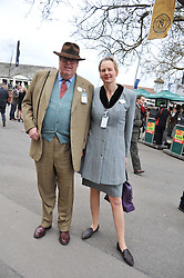 The HON.NICHOLAS & SERENA SOAMES at the Hennessy Gold Cup at Newbury Racecourse, Berkshire on 26th November 2011.