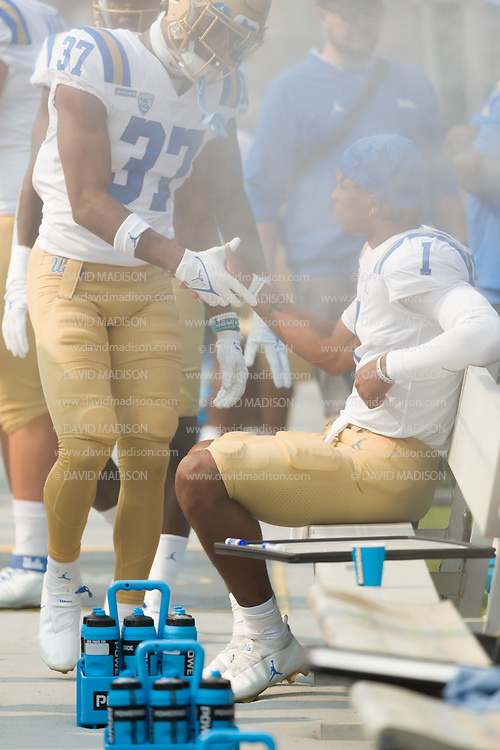 PALO ALTO, CA - SEPTEMBER 26:  Dorian Thompson-Richardson #1 and Quentin Lake #3 7of the UCLA Bruins get ready for the start of  an NCAA Pac-12 college football game against the Stanford Cardinal on September 26, 2021 at Stanford Stadium in Palo Alto, California.  (Photo by David Madison/Getty Images)