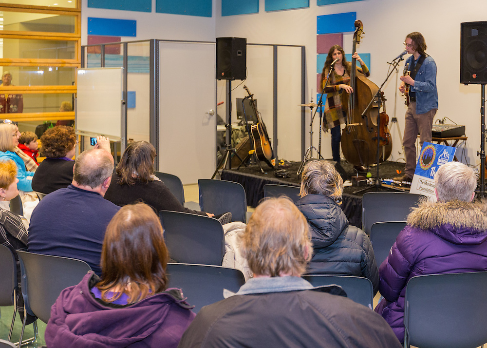 Jen Maurer and Anthony Papaleo perform in the Akron-Summit County Public Library at First Night Akron 2017 on Dec. 31, 2016.