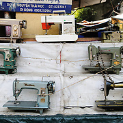 Old sewing machines on display for sale outside a shop in Hanoi, Vietnam. Along with much of southeast Asia, Vietnam has a large garment industry.