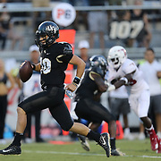 ORLANDO, FL - SEPTEMBER 21:  McKenzie Milton #10 of the UCF Knights scores on a run into the end zone during a game against the Florida Atlantic Owls at Spectrum Stadium on September 21, 2018 in Orlando, Florida. (Photo by Alex Menendez/Getty Images) *** Local Caption *** McKenzie Milton