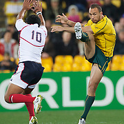 Quade Cooper, Australia, kicks past Nese Malifa, USA, during the Australia V USA, Pool C match during the IRB Rugby World Cup tournament. Wellington Stadium, Wellington, New Zealand, 23rd September 2011. Photo Tim Clayton..