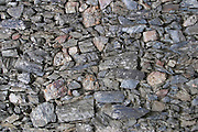 Schist rock stone wall. La Liquiere village. Faugeres. Languedoc. Terroir soil. France. Europe. Schist slate soil.