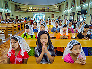 19 NOVEMBER 2017 - HWAMBI, YANGON REGION, MYANMAR: Children pray in Sacred Heart's Catholic Church in Hwambi, about 90 minutes north of Yangon, before mass Sunday. Catholics in Myanmar are preparing for the visit of Pope Francis. He is coming to the Buddhist majority country November 27-30. There about 500,000 Catholics in Myanmar, about 1% of the population. Catholicism was originally brought to what is now Myanmar more than 500 years ago by Portuguese missionaries and traders.    PHOTO BY JACK KURTZ