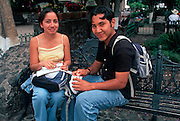 MEXICO, CUERNAVACA student couple in Plaza de Armas
