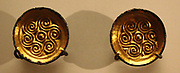 Pair of saucer brooches, gilt copper alloy.  Saxon, 450-550 Frilford, Oxfordshire.