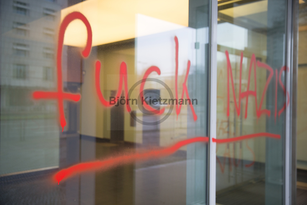 """Berlin, Germany - 14.02.2016  <br /> <br /> Unknown persons sprayed several slogans (("""" Refugees welcome"""" , """"no one is illegal"""", """"fuck nazis"""", """"AfD Nazis get out"""") at the entrance of the office building in which is also the federal office of the right-wing party Alternative for Germany (AfD) is located. <br /> <br /> Unbekannte bespruehten den Eingang eines Buerogebaeudes in dem sich auch die Bundesgeschaeftsstelle der rechten Partei AfD befindet mit Parolen (""""Refugees welcome"""", """"kein Mensch ist illegal"""", """"fuck nazis"""", """"AfD Nazis raus"""")."""