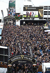 Racegoers in the Guinness Village on St Patrick's Thursday at Cheltenham Racecourse