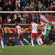 Mike Grella, (right), New York Red Bulls, scores his sides second goal during the New York Red Bulls Vs Houston Dynamo, Major League Soccer regular season match at Red Bull Arena, Harrison, New Jersey. USA. 19th March 2016. Photo Tim Clayton