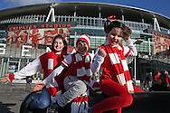 a Group of young Arsenal fans pose on the Cannon outside Emirates Stadium before k/o. The Emirates FA cup, 4th round match, Arsenal v Burnley at the Emirates Stadium in London on Saturday 30th January 2016.<br /> pic by John Patrick Fletcher, Andrew Orchard sports photography.